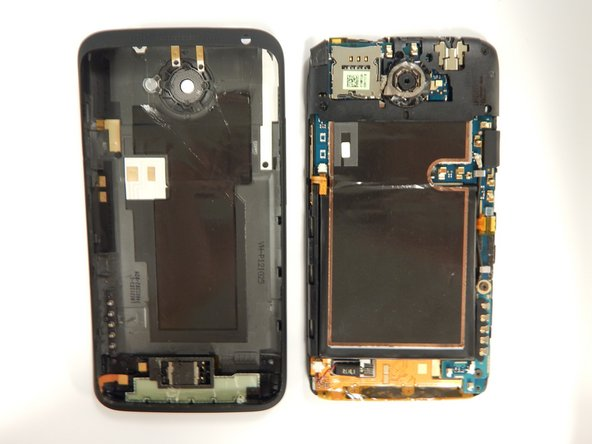 Once both sides are detached use the suction cup tool to remove the screen completely from the black casing.