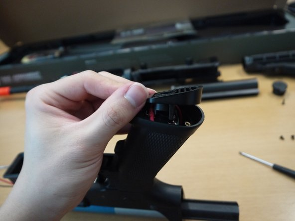 Reinstall the pistol grip plate as shown, and be sure not to pinch or mash up the wires.