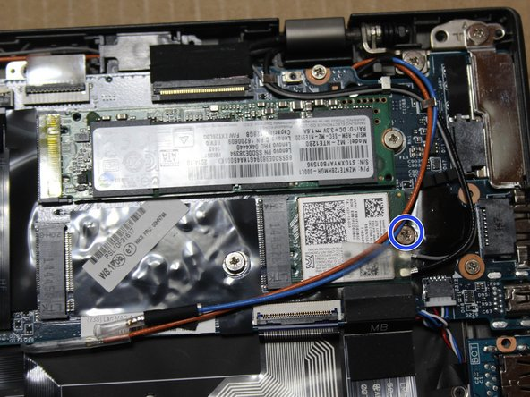Remove screw holding the wireless card in place.