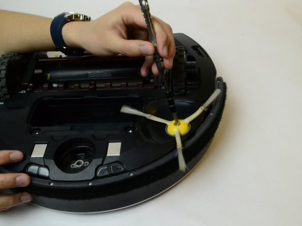 Start by locating the yellow side brush on the underside of the iRobot Roomba 860 near the front of the device.