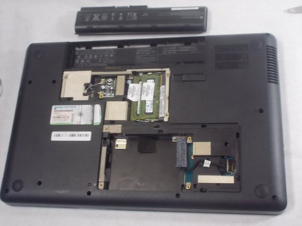 Remove the battery, RAM, and hard drive.