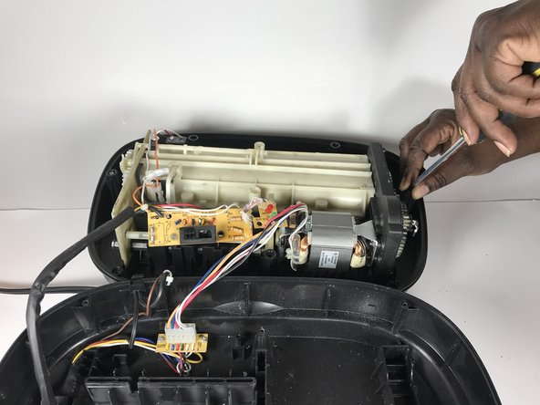 If the gears are hard to remove, use a flathead screwdriver to help remove them. The gears also may be greasy so place them on a paper towel or newspaper.