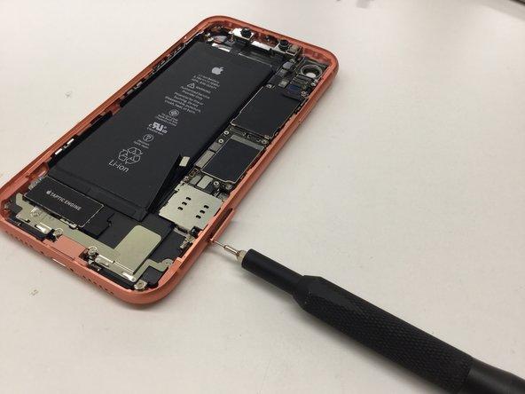 Use a SIM tool to remove the SIM tray.
