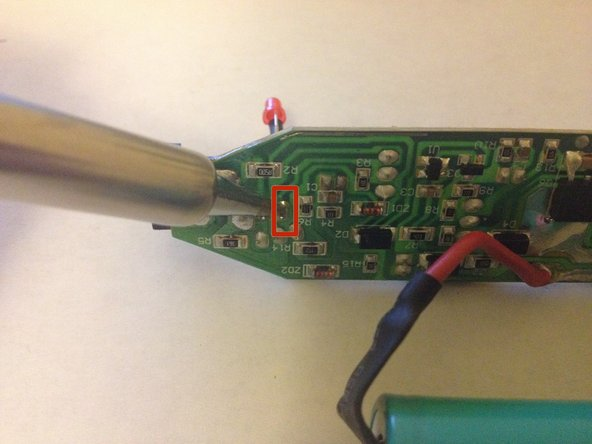 Place the positive leg of the new LED through the positive hole in the printed circuit board and solder it into place.