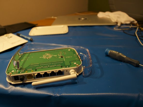Image 1/2: Use a spudger on the edge to push up the plastic casing.