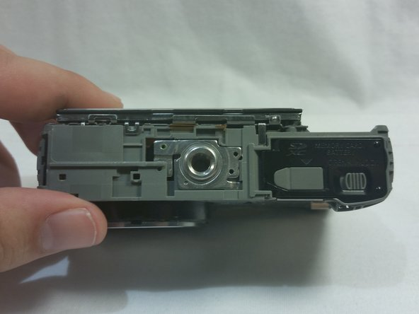 Then remove the front panel to expose the bracket at the bottom of the camera.