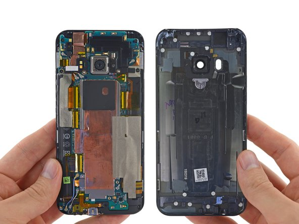 Image 3/3: As we pop the rear case of the M9, we get our first view of the tender morsels inside. At first glance, this new HTC One closely resembles the M8.