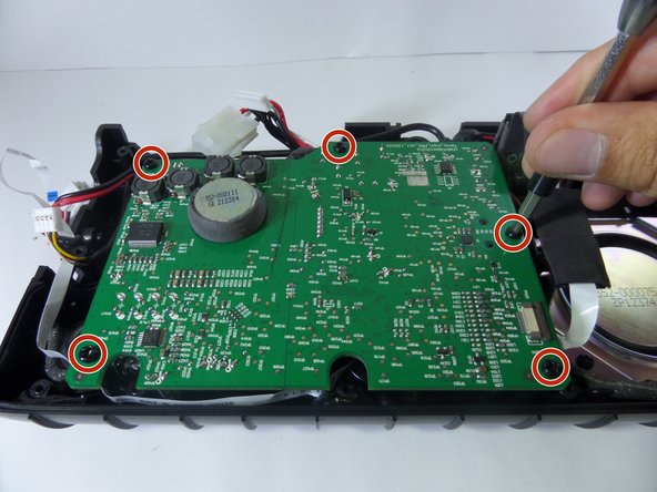 Remove five 7.0 mm screws on the motherboard with a Phillips #2.