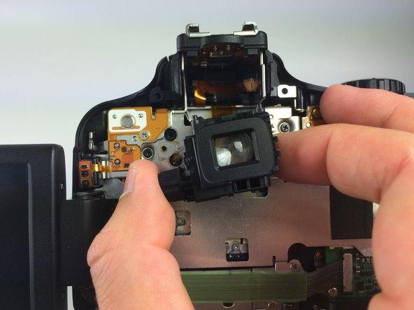 Now you can completely remove the eyepiece from the camera.