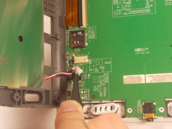 Image 2/3: Then, unplug the battery and separate the gray piece from the motherboard