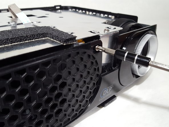 Remove the screws from the case located around the device.
