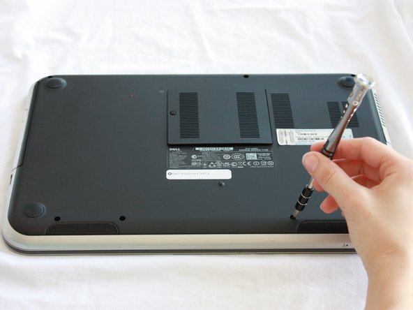 Use a J0 Bit tipped screwdriver unscrew the seven 6 mm Phillips screws on the back casing of the laptop.
