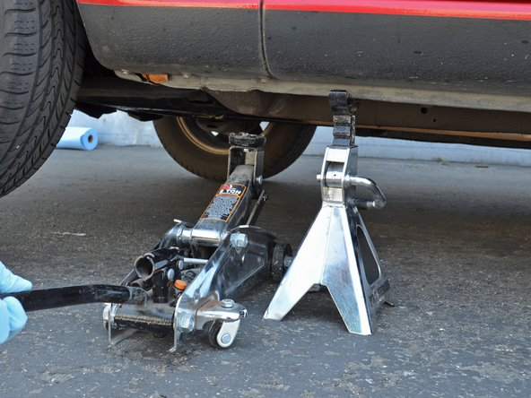 Slowly lower the jack so that the car is resting on the jack stand.