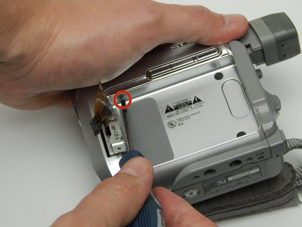 Image 1/3: For the next step make sure to be careful so as to not break any of the clips that hold the camera's two halves together.