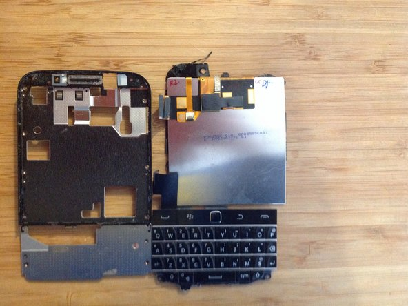 Once screws are all out, gently lift the broken digitizer. Make sure to lift between the display assembly and the black border.