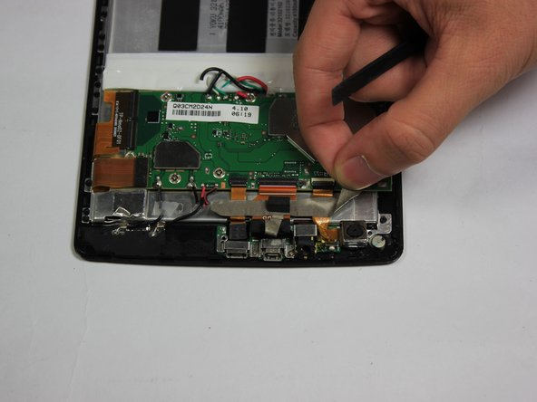 Pull back the tape holding the the front facing camera's connector strip to the device.