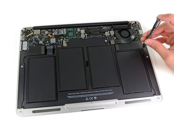 The battery is held in place by a few Torx screws.