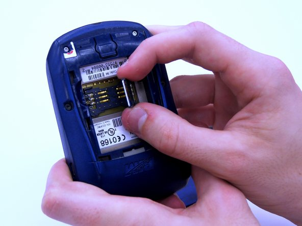 Lift the SIM card holder using your thumb and index finger.