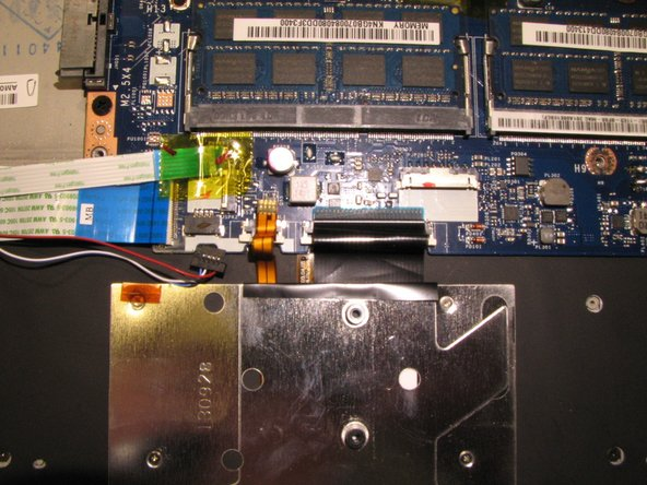 Image 3/3: Disconnect the I/O board ribbon cable.