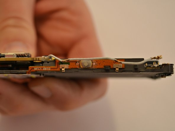 Image 2/2: Carefully disconnect the antenna from the motherboard.
