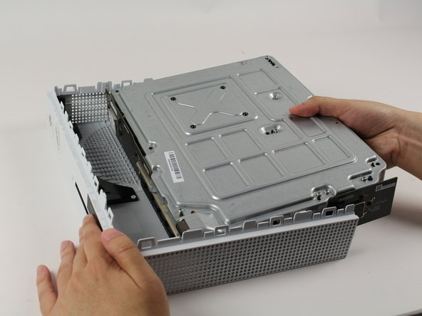 Gently separate the interior case from the white exterior case.