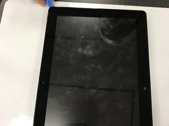With the back panel now removed, wedge the opening tools in between the actual tablet and screen and move it around parameter until you have loosened the adhesive keeping it together.
