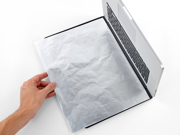 The liquid adhesive remover provided in your kit can affect the antireflective coating on your MacBook Pro's display.