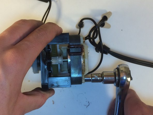 You need to remove the motor in order to reach the back of the cutter.