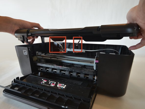 Carefully lift the top panel off of the printer.