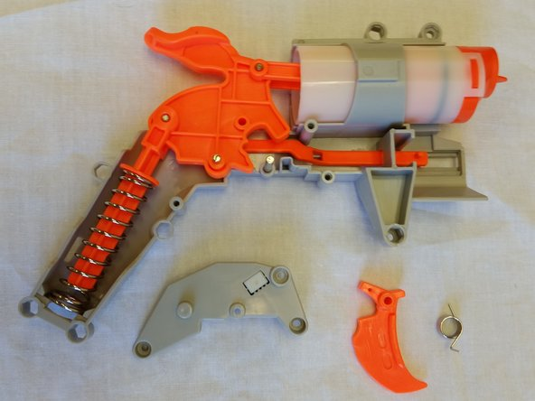 Remove the spring and trigger mechanism from the gun, and set aside.