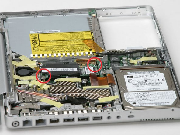 Remove the two Phillips screws from the corners of the modem.