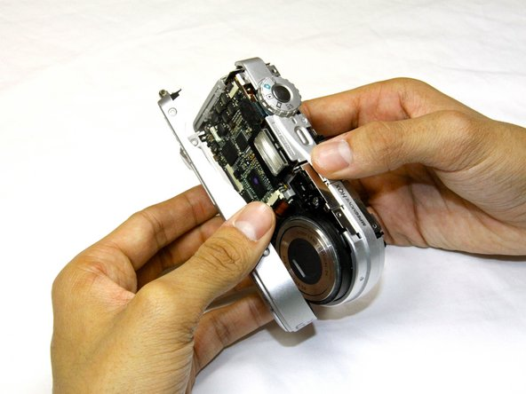 Then, pull the front case away from the rest of the camera.