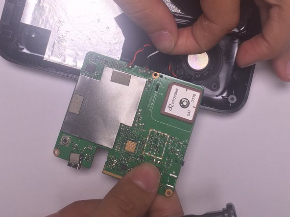 Remove the motherboard from the device by unscrewing all three 4mm screws that are connecting it to the casing with a Phillips Head screwdriver size 000.