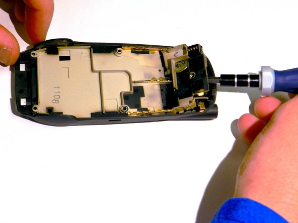 With the flat head screwdriver, remove the external speaker unit.