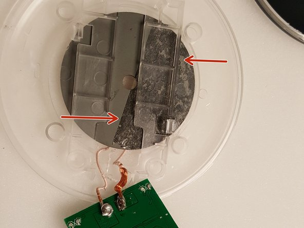 To remove charging unit:  The charging unit is held in by adhesive and connected to the circuit board (see photo 3).  Just pry from adhesive.