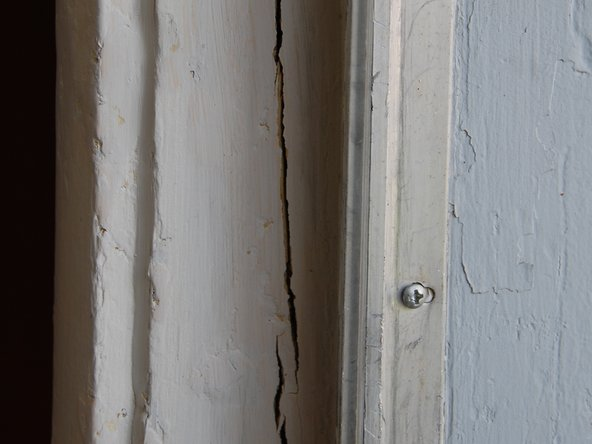 Cracked door jamb/frame caused by excessive force on door.