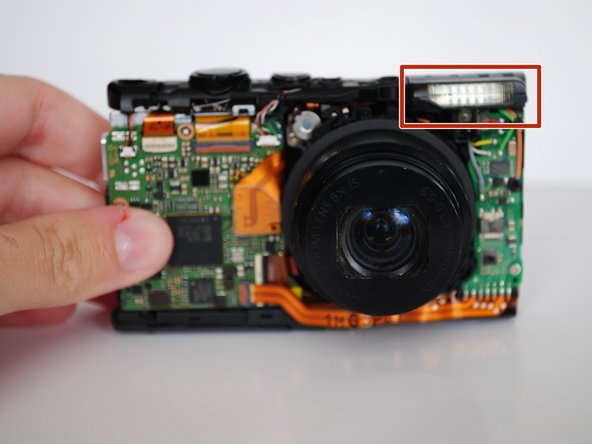 Using your hands, carefully lift the flash housing up and remove it from the area.