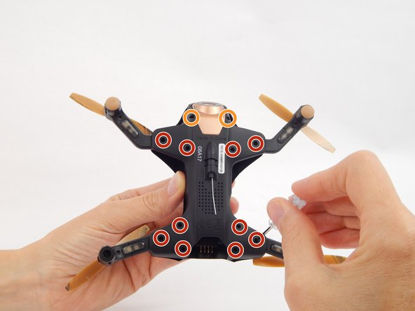 To get into the drone, twelve total screws need to be removed: