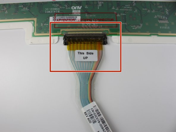 Unplug the VGA cable by pushing the two metal sides towards the middle of the strip.
