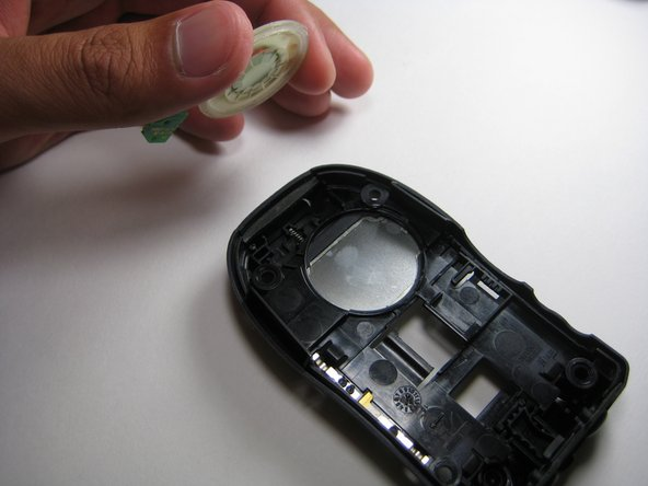 Carefully pull out the wiring and circuit board attached to the speaker system using a prying tool or tweezers.