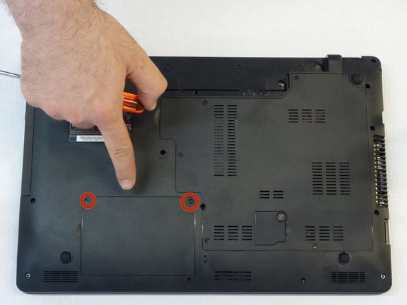 Using the Phillips # 1 screwdriver, remove the hard drive cover.