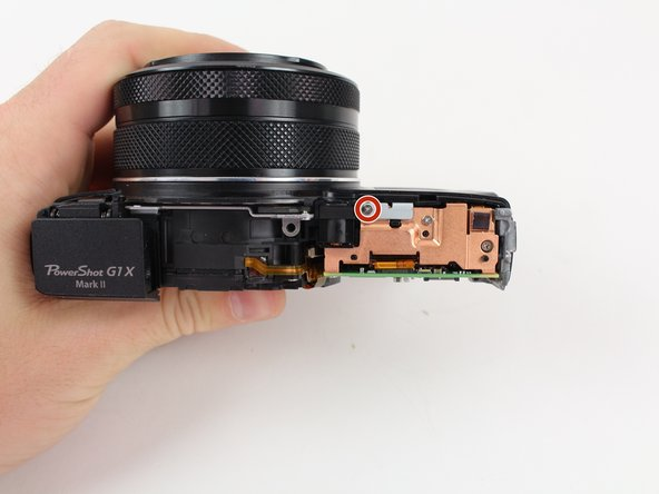 Image 1/2: Rotate the camera so the back panel is facing you.