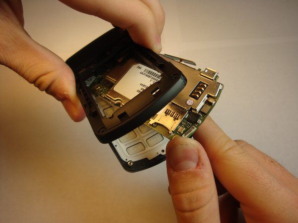 Realign motherboard so that it fits inside between the phone's covers.