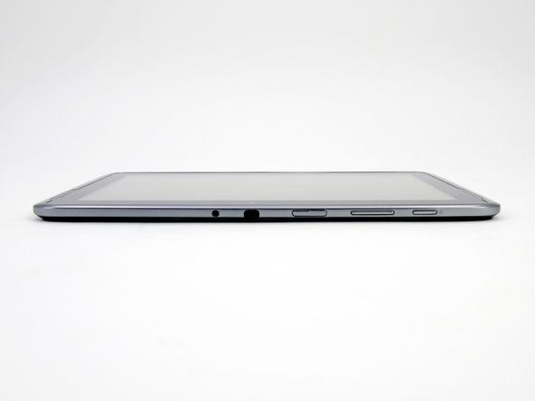 Image 2/2: The top edge of the Note 10.1 features a plethora of plugs and doodads, including the power and volume buttons, MicroSD slot, IR transceiver, and audio jack.