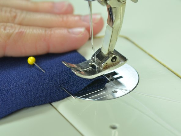 Make sure the settings on your sewing machine are set to sew a straight stitch.