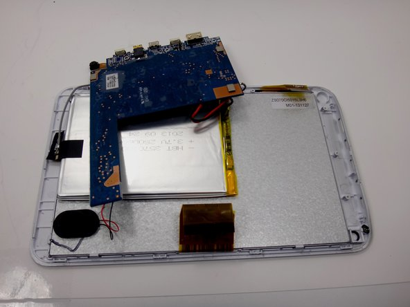 Image 3/3: Flip the motherboard over so it rests upside down and out of the way of the metal backing.
