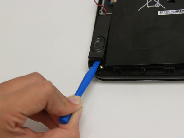 Gently lift and remove the speaker from the Chromebook.