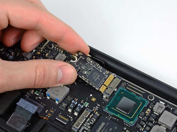 To avoid damaging its socket on the logic board, do not excessively lift the free end of the AirPort/Bluetooth card.