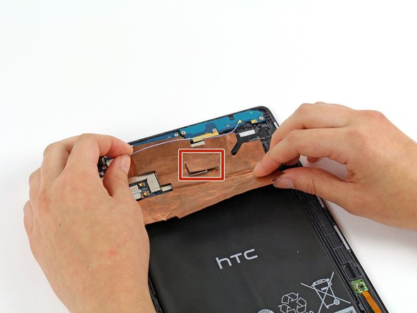 Before fully removing the copper shielding, make sure that the blue antenna cable is out of the way of the copper tab.