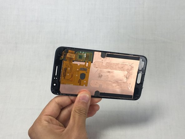 make sure the panel is completely detached from the phone frame before separating it.